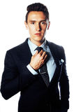 Young pretty business man standing on white background, modern hairstyle, posing emotional, lifestyle people concept Royalty Free Stock Image