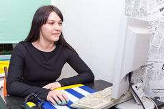Young pretty business woman with computer Stock Image