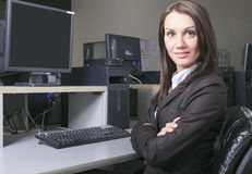 Young pretty business woman with computer in the Royalty Free Stock Images