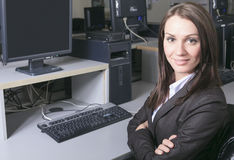 Young pretty business woman with computer in the Stock Image