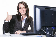 Young pretty business woman with computer in the Royalty Free Stock Photo