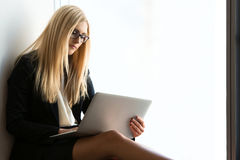 Young pretty business woman with a laptop stock images