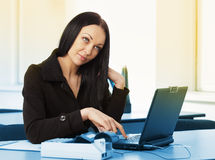 Young pretty business woman with notebook in the office Royalty Free Stock Images