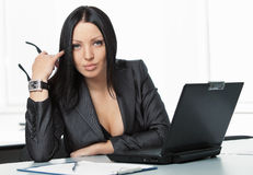 Young pretty business woman with notebook in the office Stock Photo