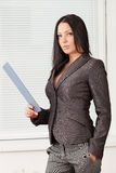 Young pretty business woman with notebook in the office Royalty Free Stock Image