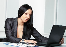 Young pretty business woman with notebook in the office Stock Photography