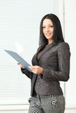 Young pretty business woman with notebook in the office Royalty Free Stock Photography