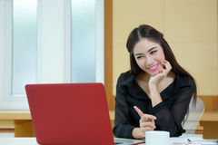 Young pretty business woman with notebook in the office Stock Image