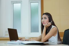 Young pretty business woman with notebook in the office.  Stock Image