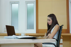 Young pretty business woman with notebook in the office Stock Images