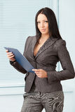 Young pretty business woman in the office Royalty Free Stock Photo