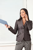Young pretty business woman in the office Royalty Free Stock Photography