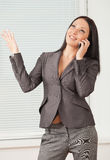 Young pretty business woman in the office Royalty Free Stock Images