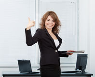Young pretty business woman in the office Stock Photography