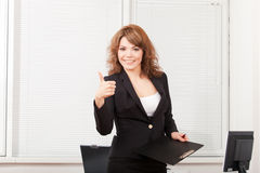 Young pretty business woman in the office Royalty Free Stock Photos