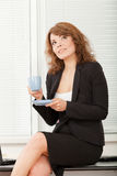 Young pretty business woman in the office Stock Images