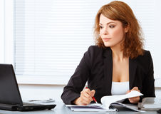 Young pretty business woman in the office Stock Photo