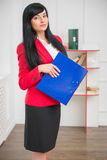 Young pretty business woman in red jacket Stock Photos