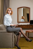 Young pretty business woman with tablet in the hotel room Stock Photos