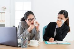 Young pretty business woman wearing medical mask. Young pretty business women wearing medical mask feeling fear when office worker manager sickness and coughing stock photo