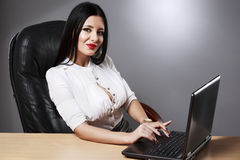 Young pretty business woman working at her office. Adult young pretty business woman working at her office Royalty Free Stock Photos