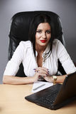 Young pretty business woman working at her office Royalty Free Stock Images