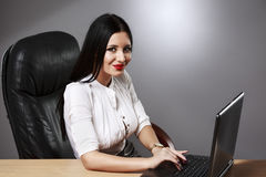 Young pretty business woman working at her office. Adult young pretty business woman working at her office Stock Photography