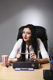 Young pretty business woman working at her office Royalty Free Stock Photography