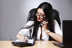 young pretty business woman working at her office Stock Photos