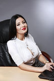 Young pretty business woman working at her office. Adult young pretty business woman working at her office Stock Image