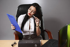Young pretty business woman working at her office. Adult young pretty business woman working at her office Stock Images