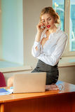 Young pretty business woman at workplace in office. Business concept Stock Image