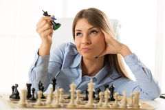 Young Pretty Businesswoman With Chessmen Stock Photo
