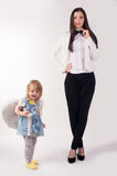 Young pretty businesswoman and her daughter Stock Image