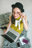 Young pretty businesswoman with laptop smiling over white backgr Stock Image