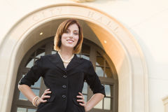 Young Pretty Businesswoman Outside in Front of City Hall Stock Photography