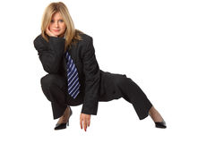 Young pretty businesswoman squats Royalty Free Stock Photo