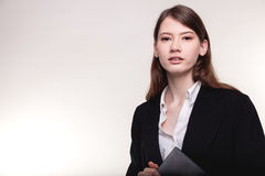 Young pretty businesswoman or student in suit stock image Stock Images