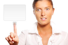 Young pretty businesswoman touching the button Royalty Free Stock Images