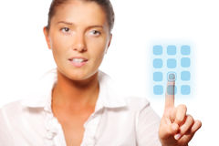 Young pretty businesswoman touching the button Stock Photo