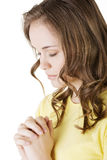 Young pretty caucasian girl praying Stock Image