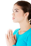 Young pretty caucasian girl praying Stock Images