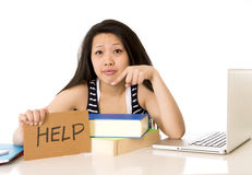 Young pretty chinese girl with help sign working Royalty Free Stock Photos