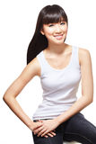 Young pretty Chinese girl with long silky hair. Young, beautiful chinese girl dressed casually in white singlet and jeans Royalty Free Stock Photo