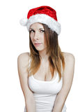 Young pretty christmas girl. Young pretty girl in a christmas hat on white Stock Images