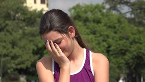 Depressed athletic hispanic teen girl. A young pretty Colombian teen girl stock video footage