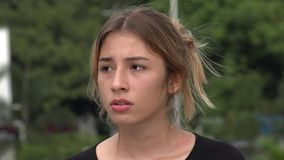 Lonely Fearful Teen Hispanic Girl. A young pretty Colombian teen girl stock video footage