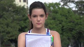 Serious Female Teen Student With Notebook. A young pretty Colombian teen girl stock video