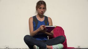 Serious Female Teenage Student. A young pretty Colombian teen girl stock video