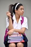 Apathetic Cute Colombian Girl Student Wearing School Uniform With Books